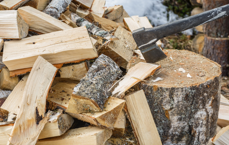 wood being chopped with a small ax