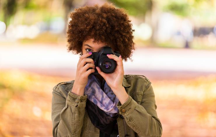 woman taking picture with nice camera