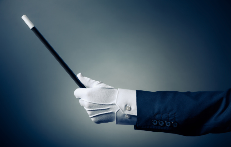 magician holding a wand