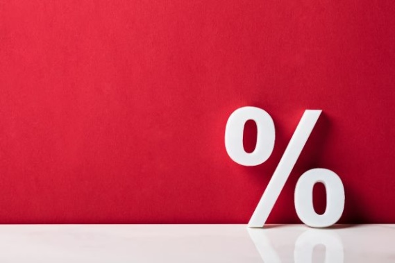 white % sign on red background