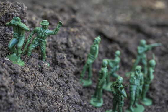 Action figures close-up. Toy soldiers following their leader.
