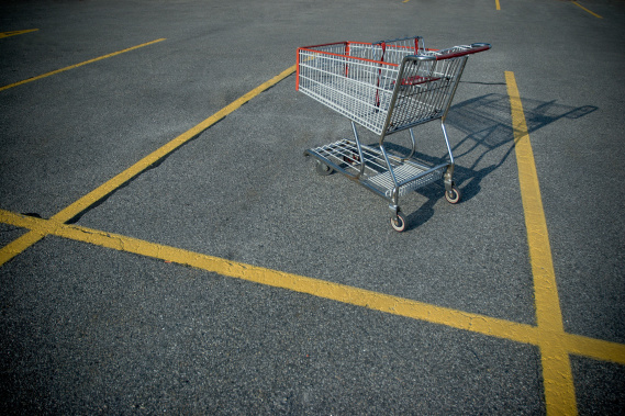 shopping cart abandoned in a parking lot