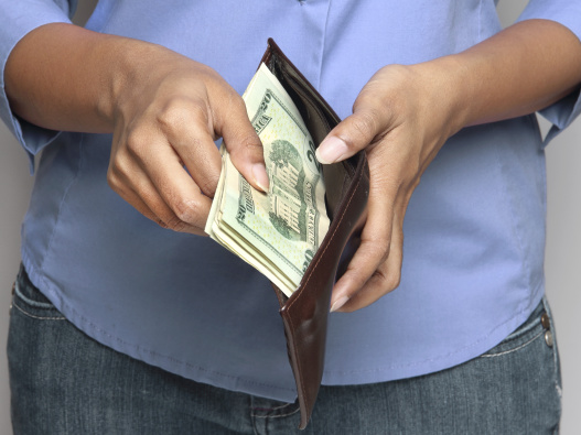 woman taking money out of a wallet