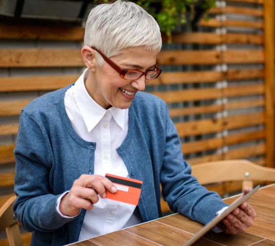 Business owner processing a credit card payment with her Stripe reader.