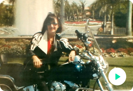Image of Peggy Sealfon, owner of Supercharge Your Life. It is an older picture of her on a motorcycle.