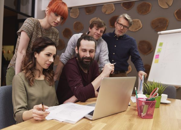 Coworkers working together on a laptop