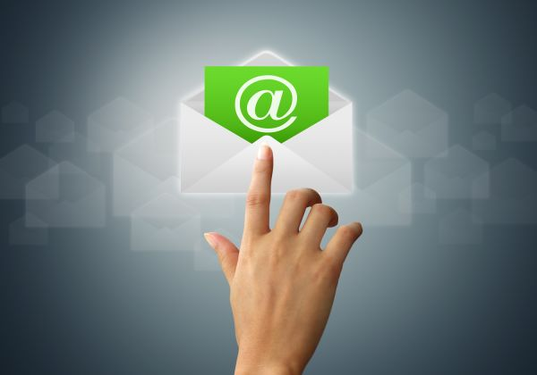 Hand with finger pointing at an envelope