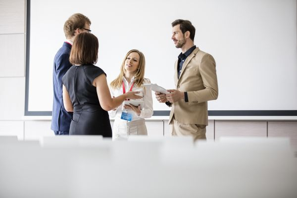 A small group of people talking at a conference