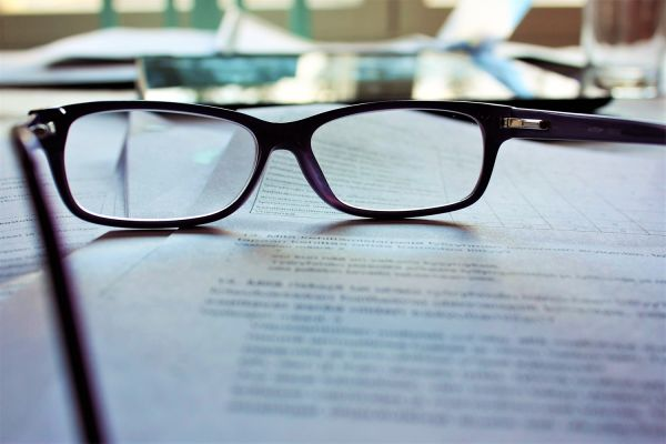 Close up of glasses on a document