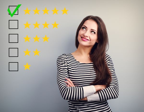 Girl looking at an illustration of 5-star rating with 5 stars selected
