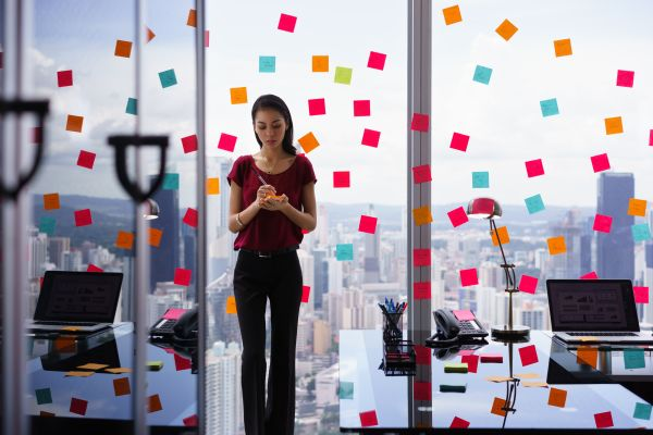 woman working with a bunch of sticky notes