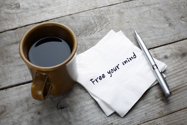 coffee and a napkin with a note saying free your mind