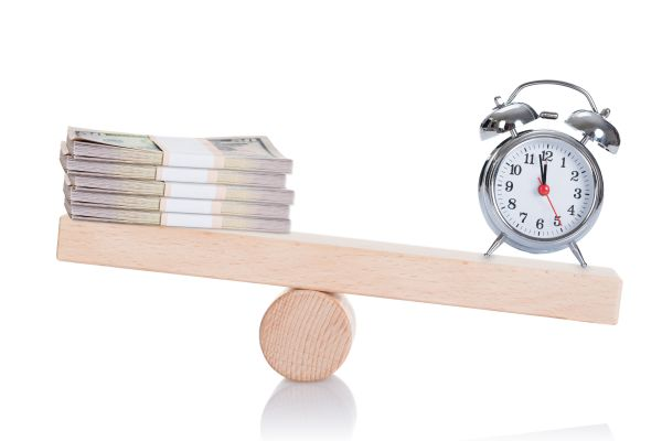 Time and money on balance scale