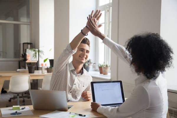 Co-workers giving each other a high-five
