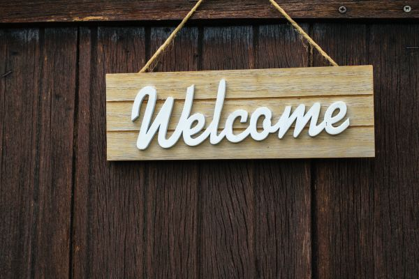 Welcome sign hanging on door
